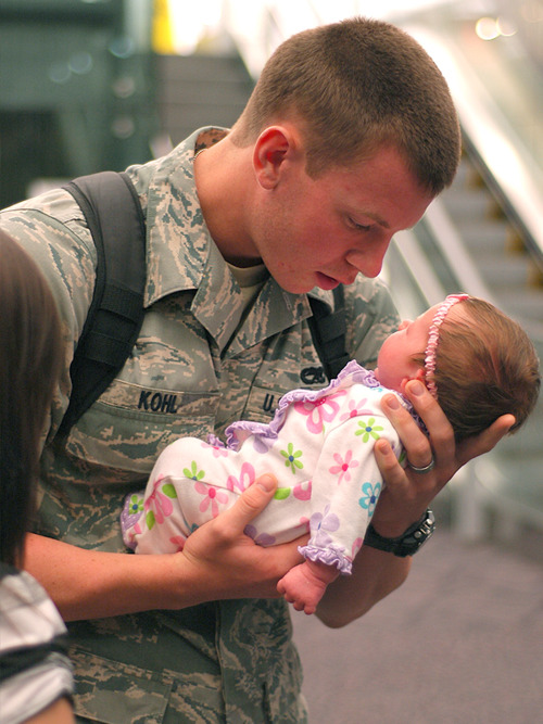 This picture was made two years ago when this US Marine saw his 3-week-old baby daughter for the first time. The young couple found out that they expecting a baby when this young guy was already away with his convoy.