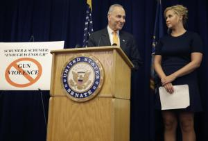 """New York Sen. Chuck Schumer and his distant cousin, Amy Schumer, speak during a news conference in New York, Monday, Aug. 3, 2015. The Schumers are teaming up to try and enact gun control regulations. They cited the recent shooting in a Louisiana movie theater that killed two women and injured nine others during a screening of the movie """"Trainwreck"""" starring Amy Schumer. (AP Photo/Seth Wenig)"""