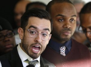 Journalist Brandon Smith, left, and activist William Calloway talk to reporters Thursday, Nov. 19, 2015, after a Cook County judge ordered the Chicago Police Department to release a video of an officer fatally shooting 17-year-old Laquan McDonald by Nov. 25, in Chicago. The video is said to show the officer shooting McDonald 16 times in October 2014. (AP Photo/Charles Rex Arbogast)