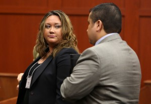 Shellie Zimmerman, left, looks at her husband George Zimmerman as they leave the court room during a recess in his trial at Seminole circuit court in Sanford, Fla., Friday, June 14, 2013. Zimmerman has been charged with second-degree murder for the 2012 shooting death of Trayvon Martin.(AP Photo/Orlando Sentinel, Gary W. Green, Pool)