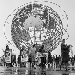 CORE picketers march in the shadow of the Unisphere at the 1964 World's Fair.