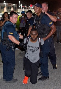 Police officers arrest activist DeRay McKesson