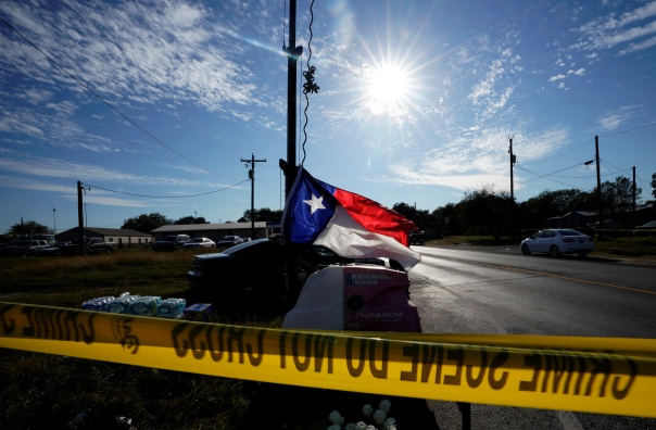 A recently hung Texas state flag flies near the site of the shooting at the First Baptist Church of Sutherland