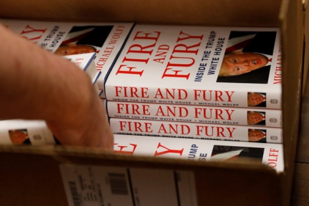 "An employee of Book Culture book store unloads copies of ""Fire and Fury: Inside the Trump White House"" by author Michael Wolff inside the store in New York"